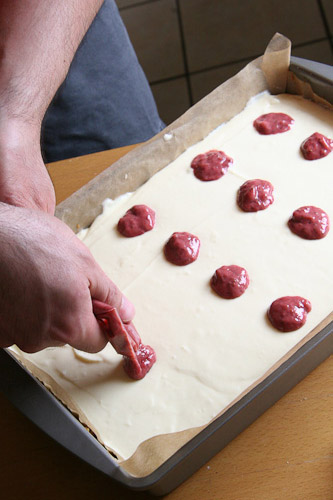 Piping the red strawberry dots