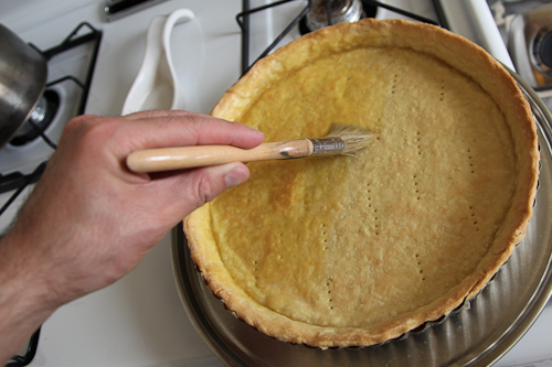 Brush inside of tart crust with egg wash