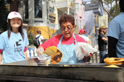 Cooking up a storm at the El Buen Comer booth. jpg