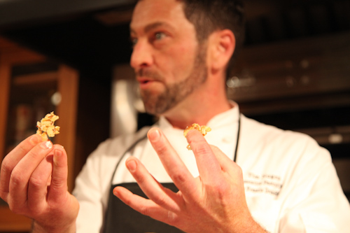 Pastry Chef Tim Nugent showing us his salted almond pralines. jpg