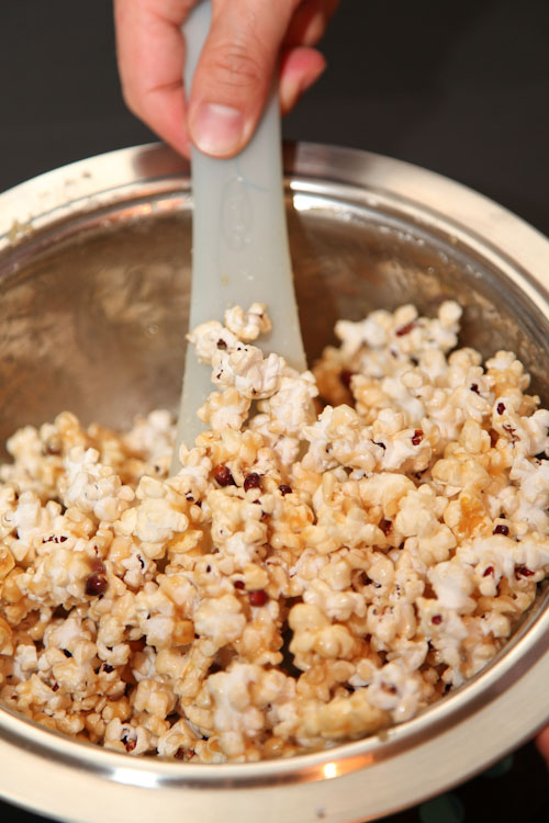 Toss the popcorn to coat it evenly with the caramel