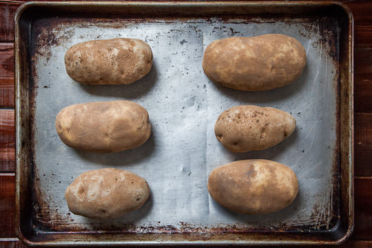 Baking the potatoes. Be sure to prick them all around with a fork. Photo by Irvin Lin of Eat the Love. www.eatthelove.com