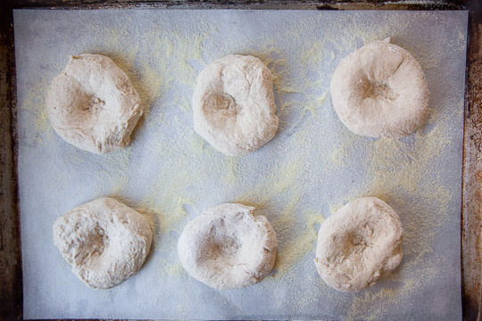 Form the bialy dough so there are depressions in the middle of each disk of dough. Photo by Irvin Lin of Eat the Love.