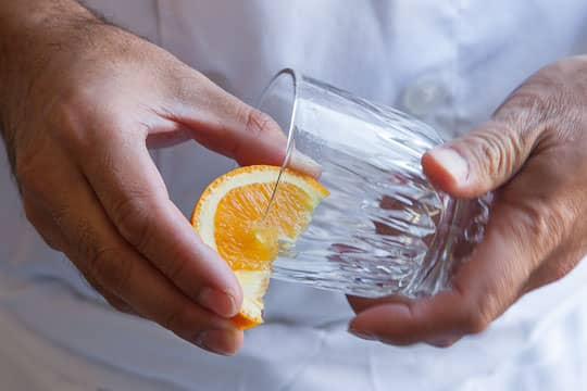 Rub the rim of the glass with an orange wedge. Photo by Irvin Lin of Eat the Love.