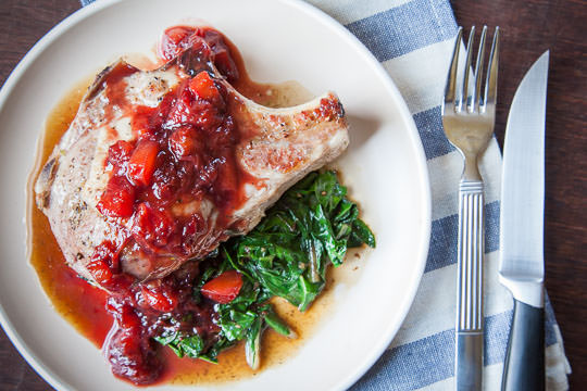 Stuffed Pork Chop Recipe with Chard, Cherries and a Plum Balsamic Reduction Glaze. Recipe and Photo by Irvin Lin of Eat the Love.