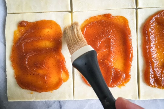Brush the untouched edges of pastry with the egg wash.