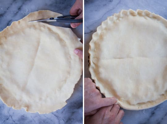 Crimp together the crust then cut the excess crust off.