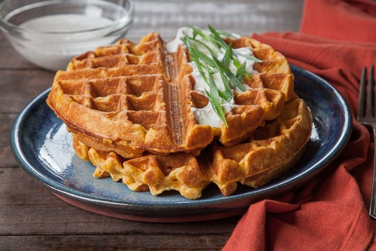 Savory Sweet Potato Waffles with Garlic Creme Fraiche. Recipe and photo by Irvin Lin of Eat the Love.