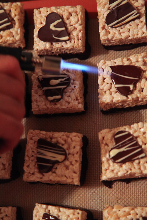 Using a torch to melt them to the treats