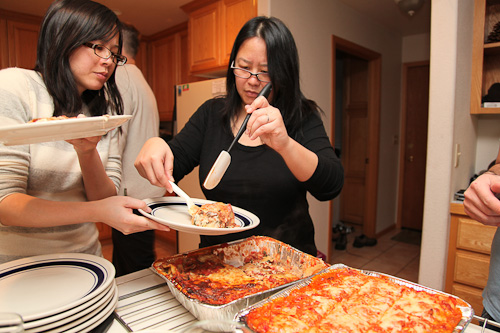 Stella and Felisa serving up lasagna