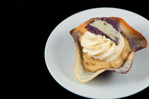 Star Anise infused Maple Mousse in a Blueberry and Lemon Tuile Cup topped with White Chocolate Whipped Cream
