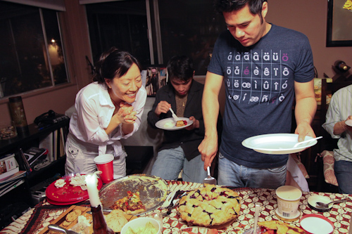 My friend Rita, praying to the altar of the Boozy Blueberry Cherry Red Wine Pie. jpg