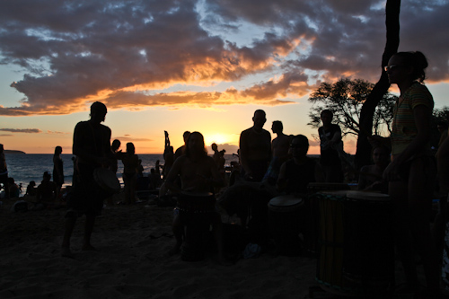 A hodge podge of people hangout at Little Beach at Sunset on Sundays.