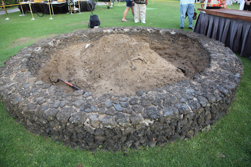 The underground fire pit, called an imu, which is roasting the kalua pig. jpg