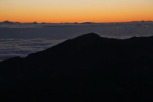 The sun just starting to crest at Mt. Haleakala. jpg