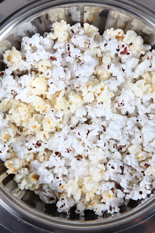 Pour the popcorn into a large heatproof bowl