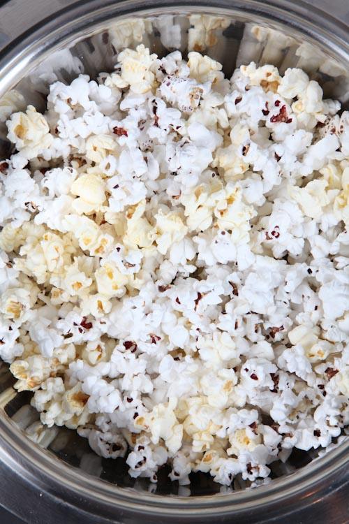 Pour the popcorn into a large heatproof bowl