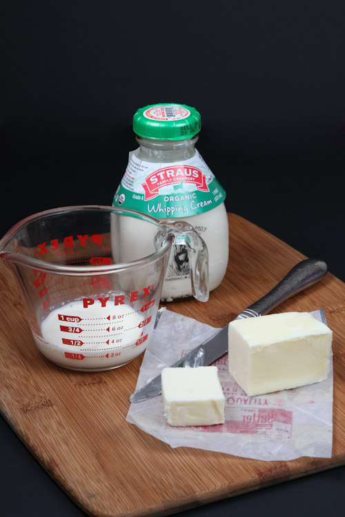 Measure out 1/4 cup of heavy whipping cream and 2 tablespoons (1/4 a stick) of unsalted butter