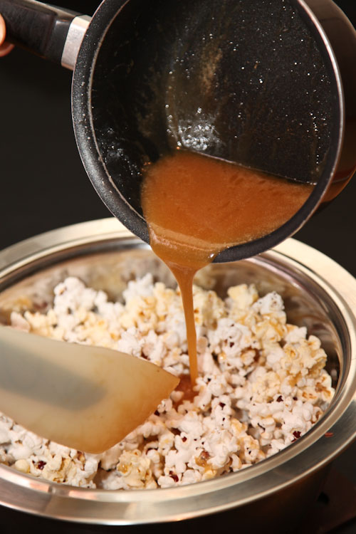 drizzle the caramel over the popcorn