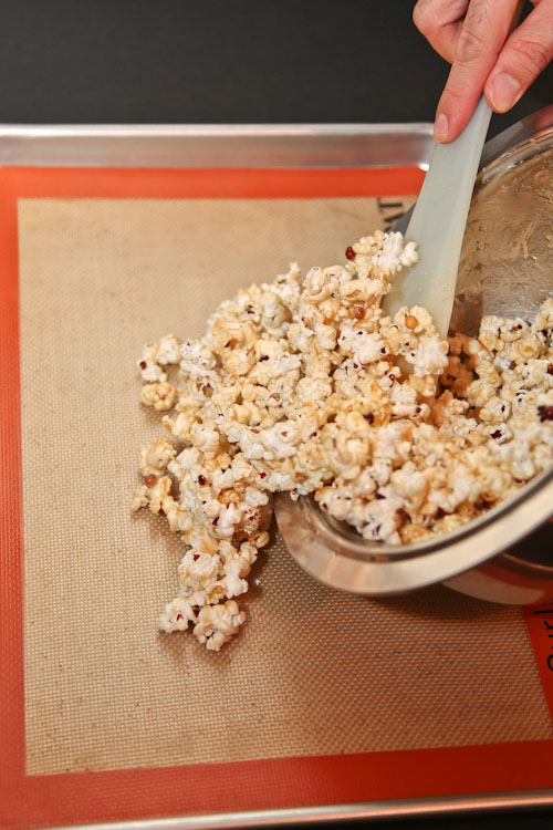 Pour the popcorn onto a baking sheet lined with a silpat