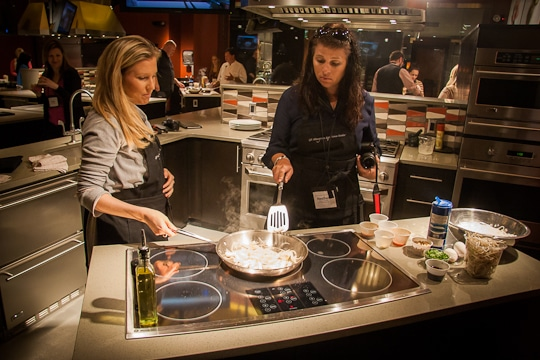 Lisa and Heather cooking up a storm on the induction stovetop.