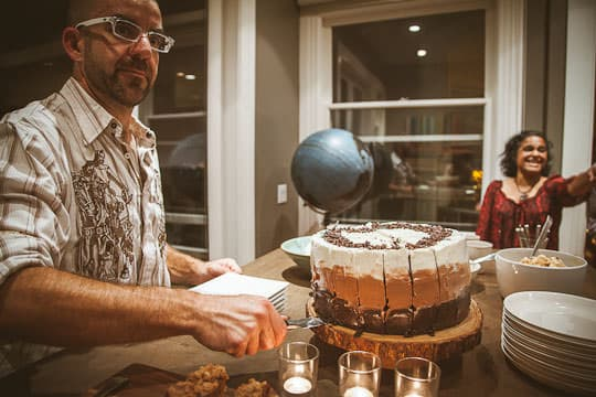 AJ slicing into the Gluten Free Ombre Cake. Photo by Irvin Lin of Eat the Love | www.eatthelove.com