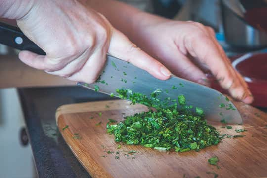 Chopping the herbs. Photo by Irvin Lin of Eat the Love. www.eatthelove.com