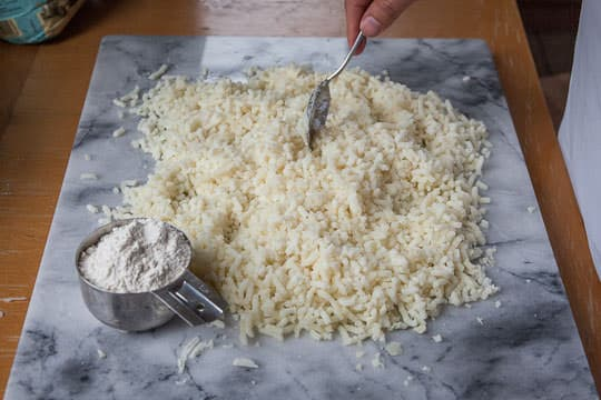 Push around the riced potatoes until spread out and cool. Photo by Irvin Lin of Eat the Love. www.eatthelove.com