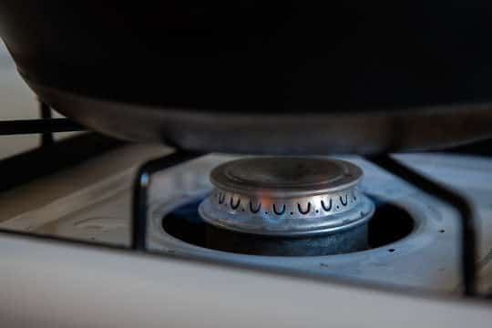 A close up of the flame under the pot so you can see it on. Photo by Irvin Lin of Eat the Love. www.eatthelove.com