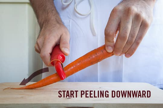 Peeling carrots starts with holding the carrot at 45˚ and peeling downward. Photo and technique by Irvin Lin of Eat the Love. www.eatthelove.com