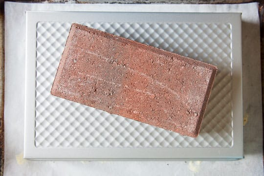 Place a 9 x 13 baking pan over the bialys and then a brick on top of the pan. Photo by Irvin Lin of Eat the Love.