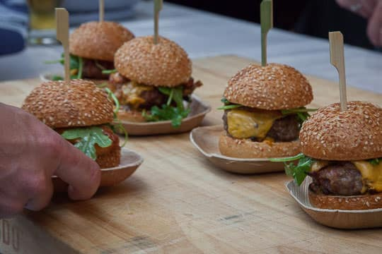 Lardo's Smokey Pork Burger with grilled peaches. Photo by Irvin Lin of Eat the Love.