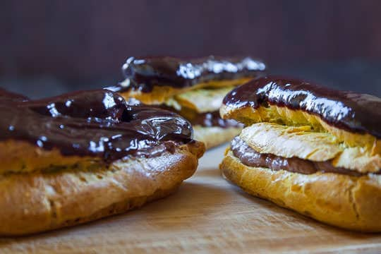 Pumpkin Eclair recipe with Chocolate Beer Pastry Cream and Chocolate Beer Ganache Glaze. Recipe and Photo by Irvin Lin of Eat the Love.