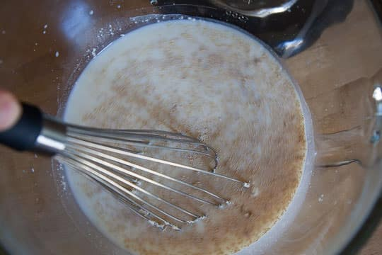 Whisk the yeast into the warm milk until dissolved. Photo by Irvin Lin of Eat the Love.