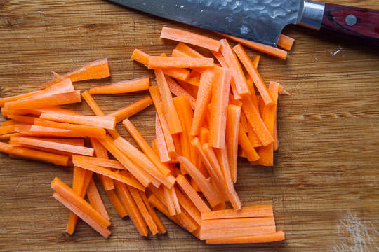 Cut the carrots into matchsticks for the Korean japchae. Photo by Irvin Lin of Eat the Love.