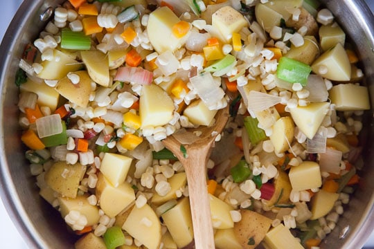 Add the corn and potato and cook for a few more minutes. Photo by Irvin Lin of Eat the Love.