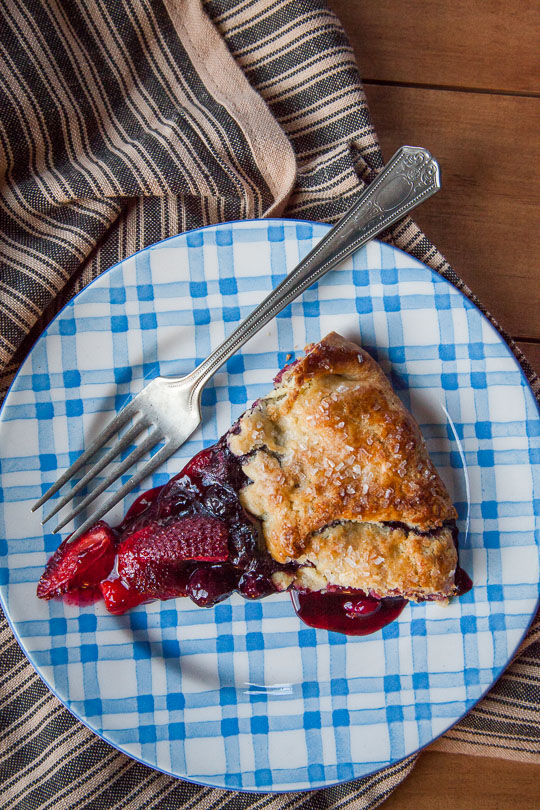 Berry galette with blueberries, strawberries and a crisp corn crust! Photo and recipe by Irvin Lin of Eat the Love.