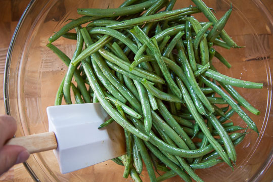 Toss the green beans with olive oil and salt and pepper. Photo and recipe by Irvin Lin of Eat the Love.