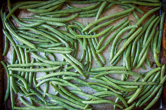 Place the coated green beans on a rimmed baking sheet in a single layer. Photo and recipe by Irvin Lin of Eat the Love.
