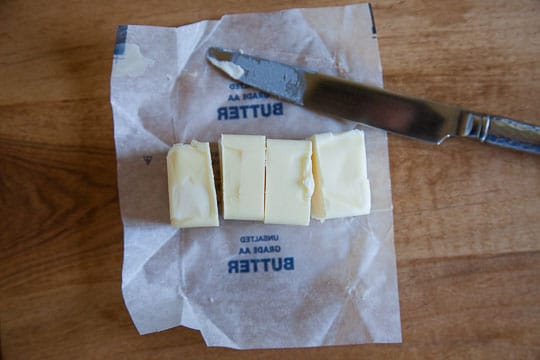 Cut the butter into quarters, or two tablespoons each. Photo and tip by Irvin Lin of Eat the Love.