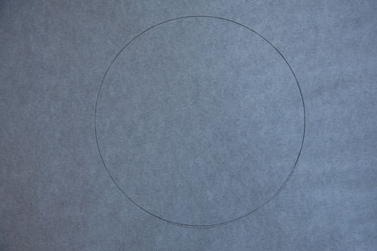 You should have a circle outlined on the paper. Photo and tutorial by Irvin Lin of Eat the Love.