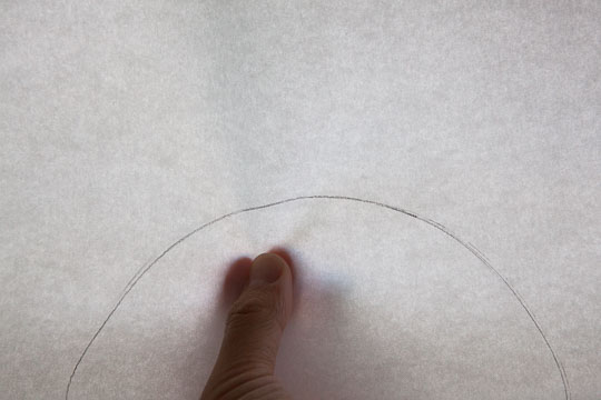 Fold the paper in half so the circle outline matches. Photo and tutorial by Irvin Lin of Eat the Love.
