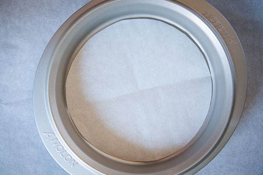 Making easy parchment paper rounds. Photo and tutorial by Irvin Lin of Eat the Love.