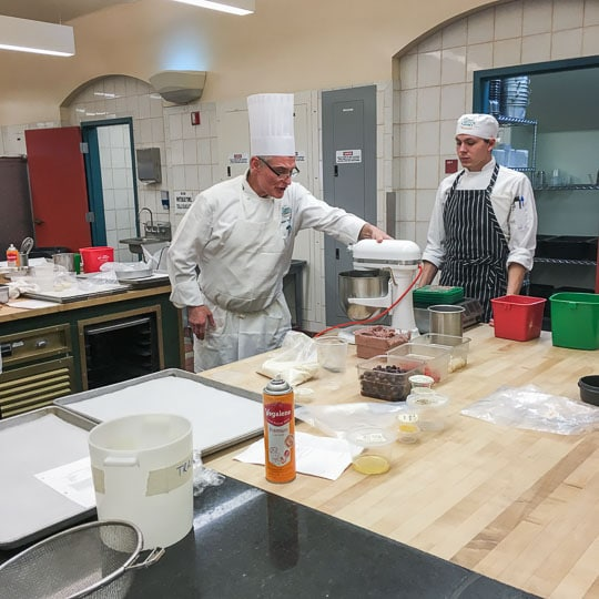 Chef and helper student at the Culinary Institute of American in Greystone. Photo by Irvin Lin of Eat the Love.