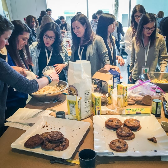 Teaching a workshop on making the perfect chocolate chip cookie recipe.