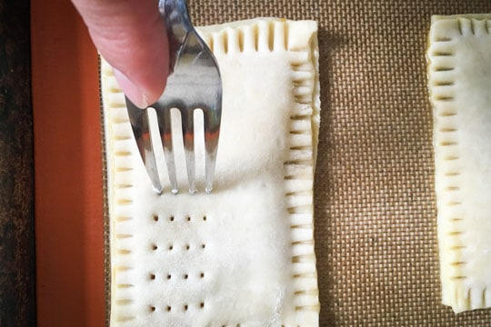 Prick holes on the top of the pastry with your fork.