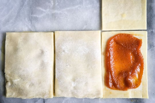 Cover the pumpkin butter rectangles with the untouched pastry rectangles.