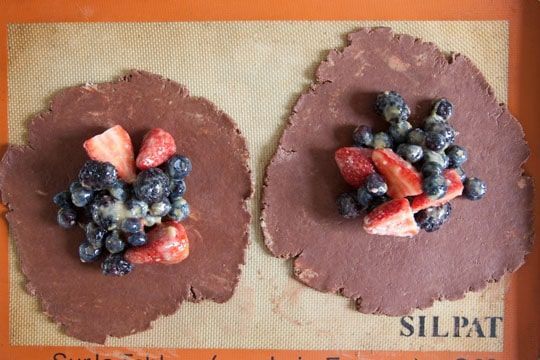 Move disks to a lined baking sheet and then divide the filling onto the two crusts.