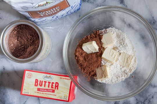 Place the dry ingredients for the crust in the bowl then add the cold butter.