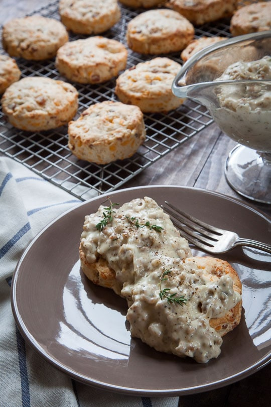 Bacon and cheddar biscuits with sausage and herb cream gravy. Recipe and photo by Irvin Lin of Eat the Love.